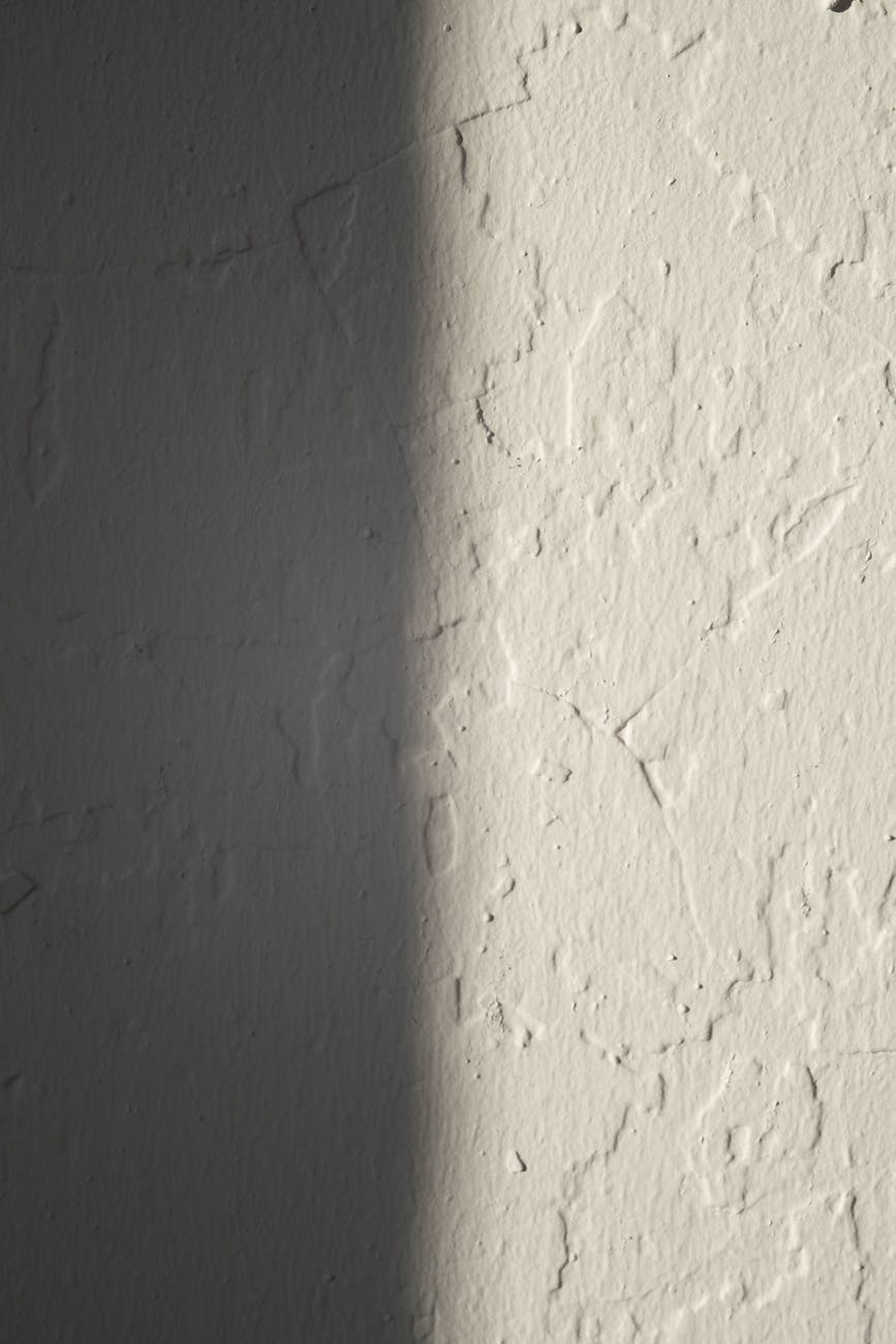 rough concrete wall of white color WHY DOES YOUR HOUSE CLADDING MATTER?